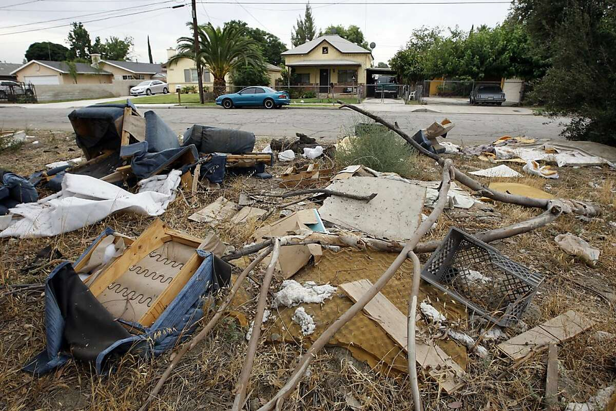 SAN BERNARDINO, CA - JULY 12: An illegal dump site in a residential neighborhood remains unattended to on July 12, 2012 in San Bernardino, California. The San Bernardino City Council voted this week to file for Chapter 9 bankruptcy protection, making San Bernardino the second largest municipality in the nation ever to file for bankruptcy and the third in California to opt for bankruptcy in the past two weeks. Stockton, California with a population of nearly 300,000, became the biggest when it filed for bankruptcy on July 3. The Sierra Nevada Mountains ski town of Mammoth Lakes voted for bankruptcy July 3. The city is facing a $45.8 million budget shortfall and is in danger of not making payroll for the next three months. City officials are set to discuss the next steps in the bankruptcy process and may also declare a fiscal emergency at its meeting next Monday. (Photo by David McNew/Getty Images)