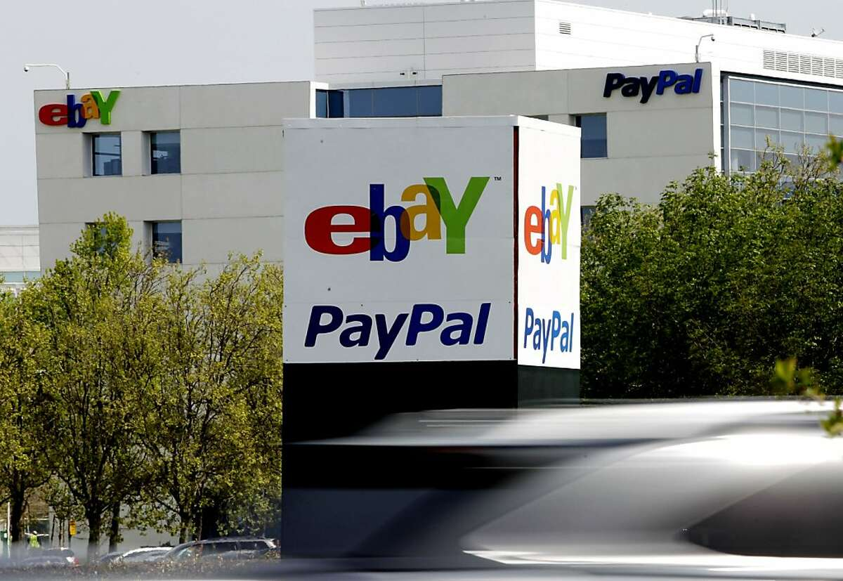 FILE - In this Thursday, March 29, 2012 file photo, a vehicle drives in front of the PayPal/eBay offices in San Jose, Calif. EBay Inc. more than doubled its second-quarter net income thanks to higher revenue from its PayPal online payments business and its e-commerce websites. (AP Photo/Paul Sakuma, File)