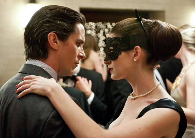 Ron Phillips/Warner Bros. Pictures L-r: CHRISTIAN BALE as Bruce Wayne and ANNE HATHAWAY as Selina Kyle in Warner Bros. Pictures? action thriller ?THE DARK KNIGHT RISES,? a Warner Bros. Pictures release. Photo: Ron Phillips / © 2012 WARNER BROS. ENTERTAINMENT INC. AND LEGENDARY PICTURES FUNDING, LLC