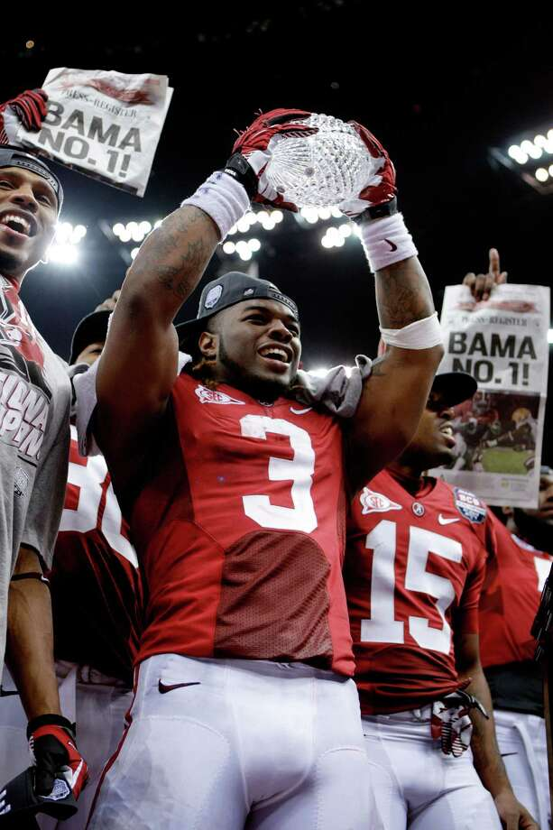 NEW ORLEANS, LA - JANUARY 09:  Trent Richardson #3 of the Alabama Crimson Tide celebrates with the trophy after defeating Louisiana State University Tigers in the 2012 Allstate BCS National Championship Game at Mercedes-Benz Superdome on January 9, 2012 in New Orleans, Louisiana. Alabama  won the game by a score of 22-0. Photo: Andy Lyons, Getty Images / 2012 Getty Images
