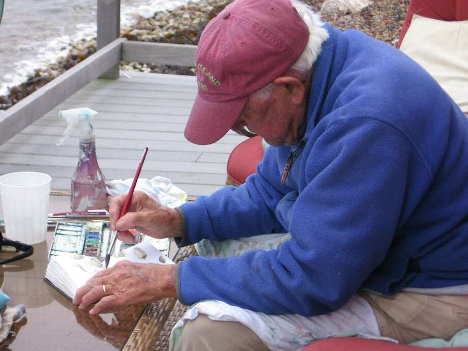 "Charlie Ferguson painting at his residence, ""Flounder In,"" on Fishers Island, N.Y., in 2008. Photo by Marnie Ferguson Briggs Photo: Contributed Photo"