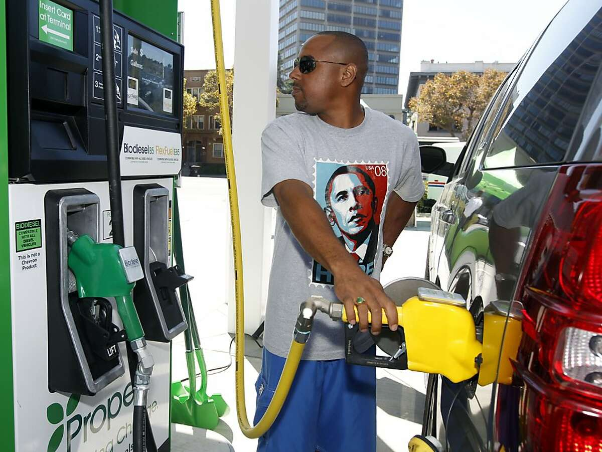 """Kwame Satterfield pumps E85 ethanol flex fuel into his Chevy Tahoe at a Propel gas station in Oakland, Calif. which opened for business on Tuesday, Aug. 31, 2010. Satterfield bought the SUV, which runs on flex fuel as well as unleaded gas, with the intention of running it on the ethanol gas, but had yet to find any stations that offered it. As luck would have it, Satterfield was getting a haircut down the street and noticed the new station as he was driving by. """"Plus, $2.49 a gallon is pretty cool,"""" he said. Propel plans on operating up to 20 stations in the Bay Area region."""