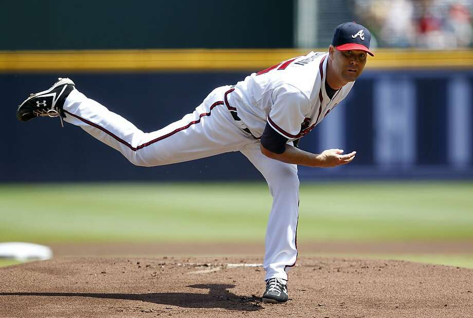 Tim Hudson, shown beating the Giants in Atlanta in 2012, says his recovery from a 2013 ankle injury is progressing well. Photo: John Bazemore, Associated Press