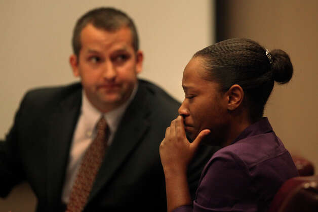 Defendant Tiffany James cries next to defense attorney Robert Gebbia, left, during the first day of her trial for the murder of Antwan Wolford in the 399th District Court in San Antonio on Thursday, July 19, 2012. Photo: Lisa Krantz, San Antonio Express-News / San Antonio Express-News
