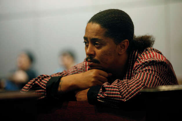 Dawayne Huggins, the step-father of Antwan Wolford, watches a witness testifying during the first day of the trial for Tiffany James, who is charged with the murder of Wolford, in the 399th District Court in San Antonio on Thursday, July 19, 2012. Photo: Lisa Krantz, San Antonio Express-News / San Antonio Express-News