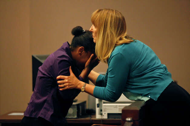 Carol De Leon, right, comforts Tiffany James during the first break on the first day of the trial for James, who is charged with the murder of Antwan Wolford, in the 399th District Court in San Antonio on Thursday, July 19, 2012. De Leon was a teacher at Sam Houston High School where James was a student at the time she was charged with murder. De Leon has remained as her supporter. Photo: Lisa Krantz, San Antonio Express-News / San Antonio Express-News