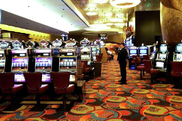 FILE - In this file photo of May 13, 2008, one of the slot machine rooms at the new MGM Grand Hotel stands ready for the start of business in Mashantucket, Ct., at the Foxwoods Resort Casino. Foxwoods, one of the world's largest casinos, has failed to make a full payment on its debt, leading to a default and another credit-rating downgrade as casinos around the country struggle amid the severe recession. (AP Photo/Bob  Child, File) Photo: Bob Child, ST / AP2008