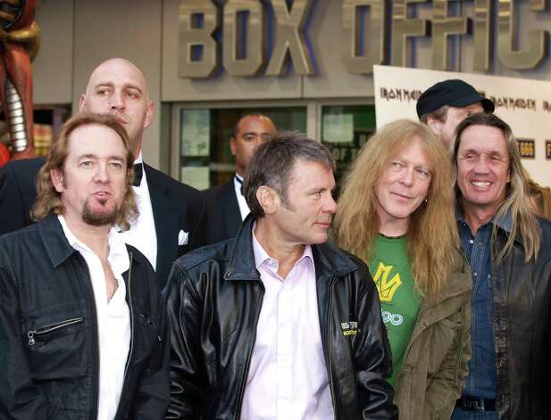 Iron Maiden (L-R) guitarist Adrian Smith, drummer Nicko McBrain, singer Bruce Dickinson, and guitarist Janick Gers arrive at London's Kensington to attend the Premiere of the film made on their tour, 'Iron Maiden: Flight 666', on April 20, 2009. AFP Photo/ Max Nash Photo: MAX NASH, AFP/Getty Images
