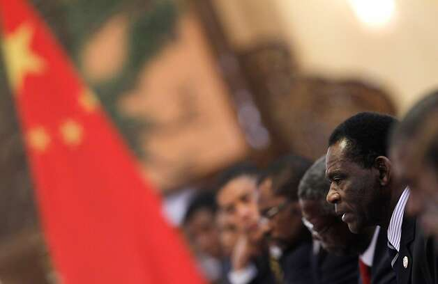 BEIJING, CHINA - JULY 19:  President of Equatorial Guinea Teodoro Obiang Nguema Mbasogo (R) speaks to his Chinese counterpart Hu Jintao (not pictured) during the 5th Ministerial Conference of the Forum on China-Africa Cooperation (FOCAC) held at the Great Hall of the People July 19, 2012 in Beijing, China. The conference will review cooperation between China and African nations with a view to the forming of a three year development plan focusing on accelerating socio-economic development.  (Photo by How Hwee Young - Pool/Getty Images) Photo: Pool, Getty Images / SF
