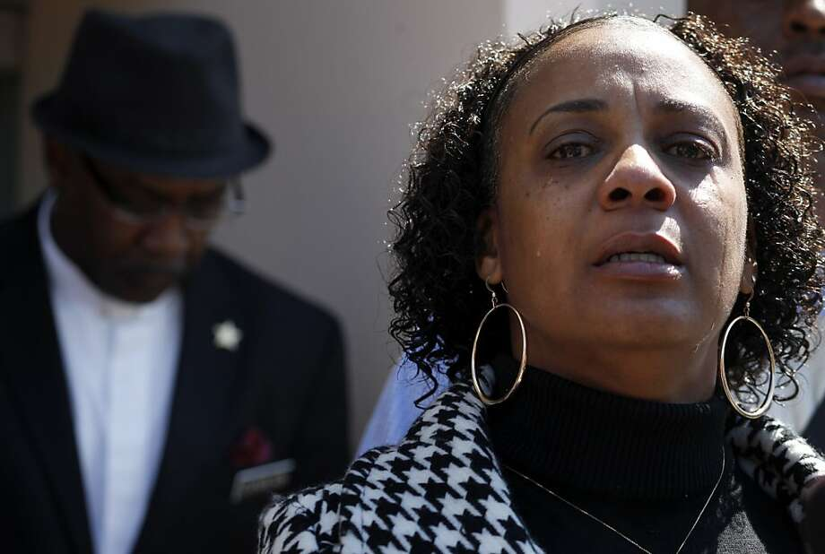 Jeralynn Blueford, cries as she addresses the media outside the Alameda County Sheriffs Coroner's Office, Thursday July 19, 2012 in Oakland, Calif. The Blueford family are asking for a copy of their son Alan Blueford's autopsy report and demanding justice for his killing. Alan,  18 years old  was killed on May 6th by an Oakland police office in East Oakland. Photo: Lacy Atkins, The Chronicle