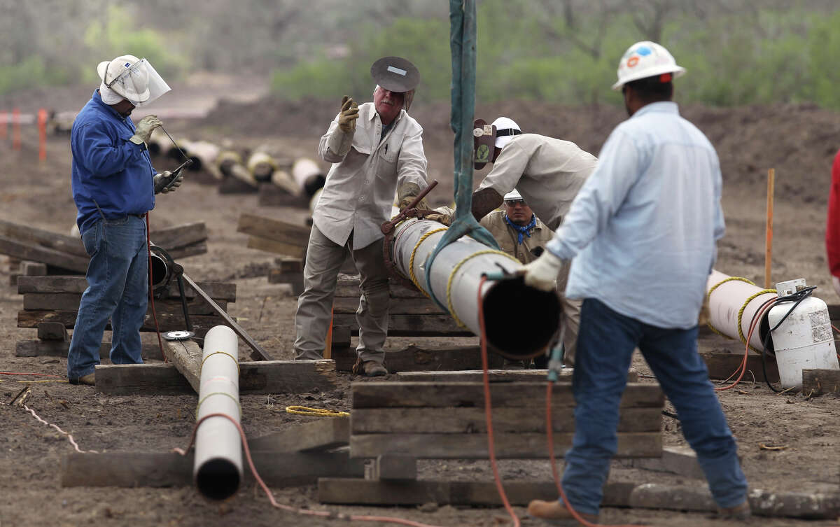 Welding crews are busy laying pipelines such as this one east of Karnes City, Texas in order to get oil and gas extracted from the Eagle Ford shale formation to market. Pipelines are critical because hauling by truck is more expensive. JOHN DAVENPORT/jdavenport@express-news.net