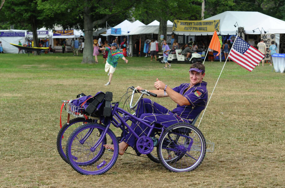 Jerry Murphy, of Armenia, NY, tools around on a custom made bicycle he made and a suit made out of Crown Royal bags, while at the Gathering of the Vibes concert at Seaside Park in Bridgeport, Conn. on Thursday July 19, 2012. Photo: Christian Abraham / Connecticut Post freelance