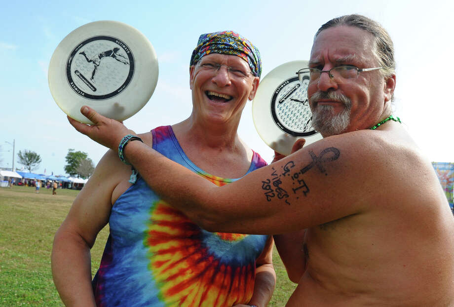 Bru Rossman, of Montclair, NJ, right, shows identical frisbees as he stands next to Mitch Fuchs, of Fairfield, while at the Gathering of the Vibes concert at Seaside Park in Bridgeport, Conn. on Thursday July 19, 2012. Bru, who never met Fuchs, saw he had the same exact frisbee, and they ended up starting to toss it around to each other. Photo: Christian Abraham / Connecticut Post freelance