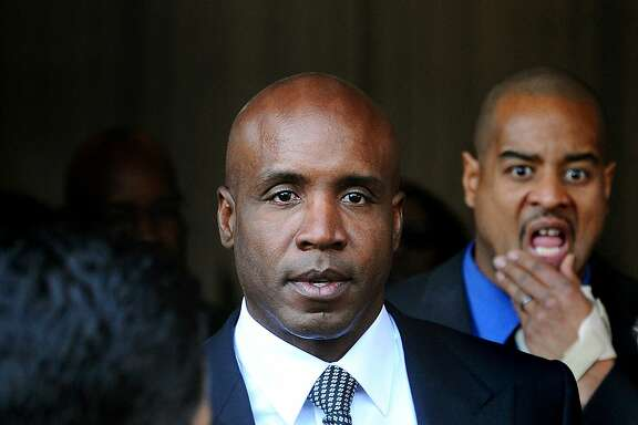 FILE - This Dec. 16, 2011 file photo shows former baseball player Barry Bonds leaving federal court after being sentenced for obstructing justice in a government steroids investigation, in San Francisco. (AP Photo/Noah Berger, File)