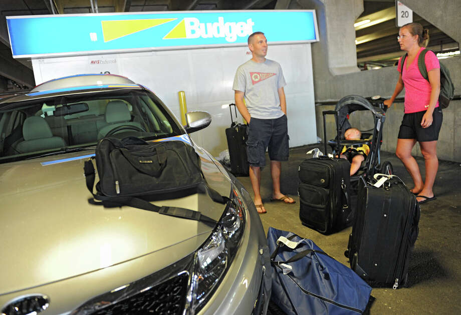Kevin Crawford, his sister-in-law Megan Crawford an her baby Kolton all of Maryland wait for Megan's husband to pick up a baby seat before loading their rental car at the Albany International Airport on Thursday, July 19, 2012 in Albany, N.Y.  (Lori Van Buren / Times Union) Photo: Lori Van Buren