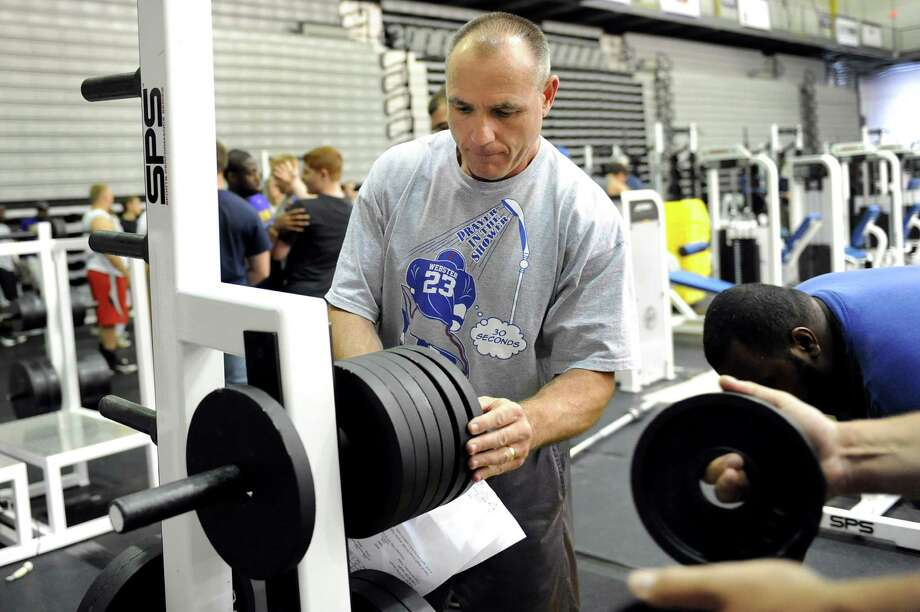 Giants strength coach Jerry Palmieri sets up the workout area for the upcoming Giants Camp on Thursday, July 19, 2012, at UAlbany in Albany, N.Y. (Cindy Schultz / Times Union) Photo: Cindy Schultz / 00018530A