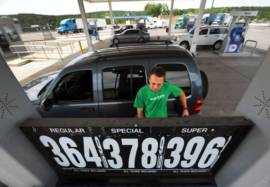 Daniel Becerra of New Jersey fuels up at the New Baltimore Service Area off the New York State Thruway in New Baltimore NY Thursday July 19, 2012. (Michael P. Farrell/Times Union) Photo: Michael P. Farrell