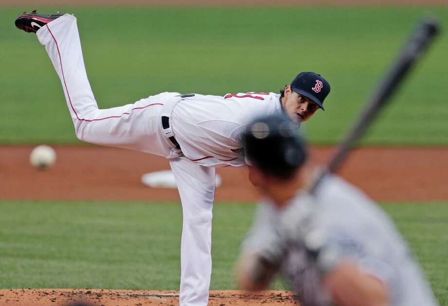 Boston Red Sox starting pitcher Clay Buchholz delivers to Chicago White Sox designated hitter Adam Dunn during the first inning of a baseball game at Fenway Park in Boston, Thursday, July 19, 2012. (AP Photo/Charles Krupa) Photo: Charles Krupa, STF / AP