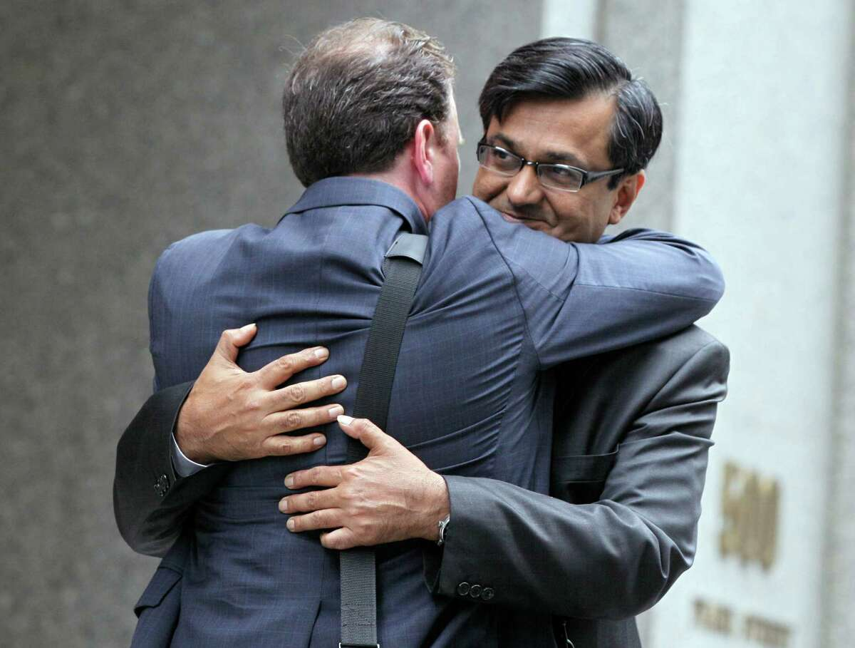 Anil Kumar, right, a former financial consultant-turned-government witness, hugs his attorney Gregory Morvillo as he leaves Federal Court in New York, Thursday, July 19, 2012. Kumar was sentenced Thursday to two years of probation after prosecutors credited him with helping convict a pair of Wall Street titans on insider trading charges. (AP Photo/Richard Drew)