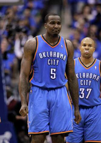 Oklahoma City Thunder's Kendrick Perkins (5) walks to the bench as Derek Fisher (37) watches during Game 3 in the first round of the NBA basketball playoffs against the Dallas Mavericks Thursday May 3, 2012, in Dallas. The Thunder won 95-79. (AP Photo/Tony Gutierrez) Photo: Tony Gutierrez, STF / AP