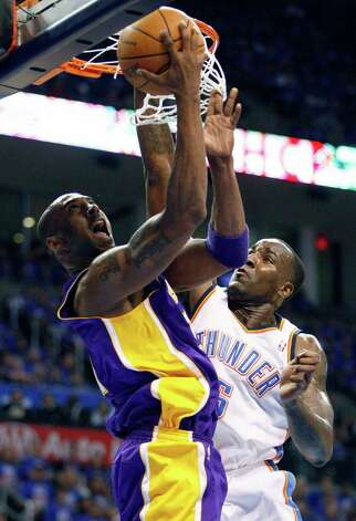 Los Angeles Lakers guard Kobe Bryant, left, goes up for a basket in front of Oklahoma City Thunder center Kendrick Perkins, right, during the first quarter of Game 5 in their NBA basketball Western Conference semifinal playoff series, Monday, May 21, 2012, in Oklahoma City. (AP Photo/Alonzo Adams) Photo: Alonzo Adams, FRE / FR159426 AP
