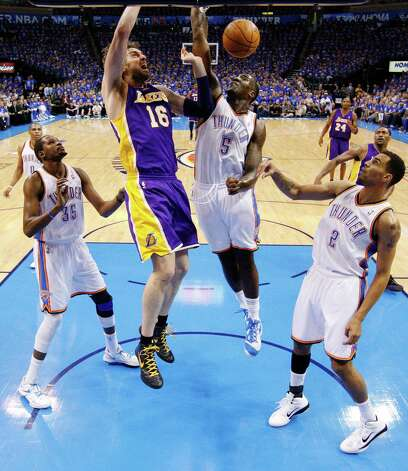 Los Angeles Lakers forward Pau Gasol (16) dunks between Oklahoma City Thunder forward Kevin Durant (35), center Kendrick Perkins (5) and guard Thabo Sefolosha (2) in the second quarter of Game 5 in their NBA basketball Western Conference semifinal playoff series, Monday, May 21, 2012, in Oklahoma City. (AP Photo/Sue Ogrocki) Photo: Sue Ogrocki, STF / AP