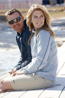 In a photo, date unknown, provided by U.S. Sailing, Zach and Paige Railey sit in Miami. The Raileys have both qualified for the London Olympics. Zach Railey, 28, knows the drill. He made his Olympic debut at Beijing, winning the silver medal in the Finn class. Paige didn't make those Olympics. She flipped her boat in the trials and lost to Anna Tunnicliffe, who went on to win the gold medal in the Laser Radial class. (AP Photo/U.S. Sailing)