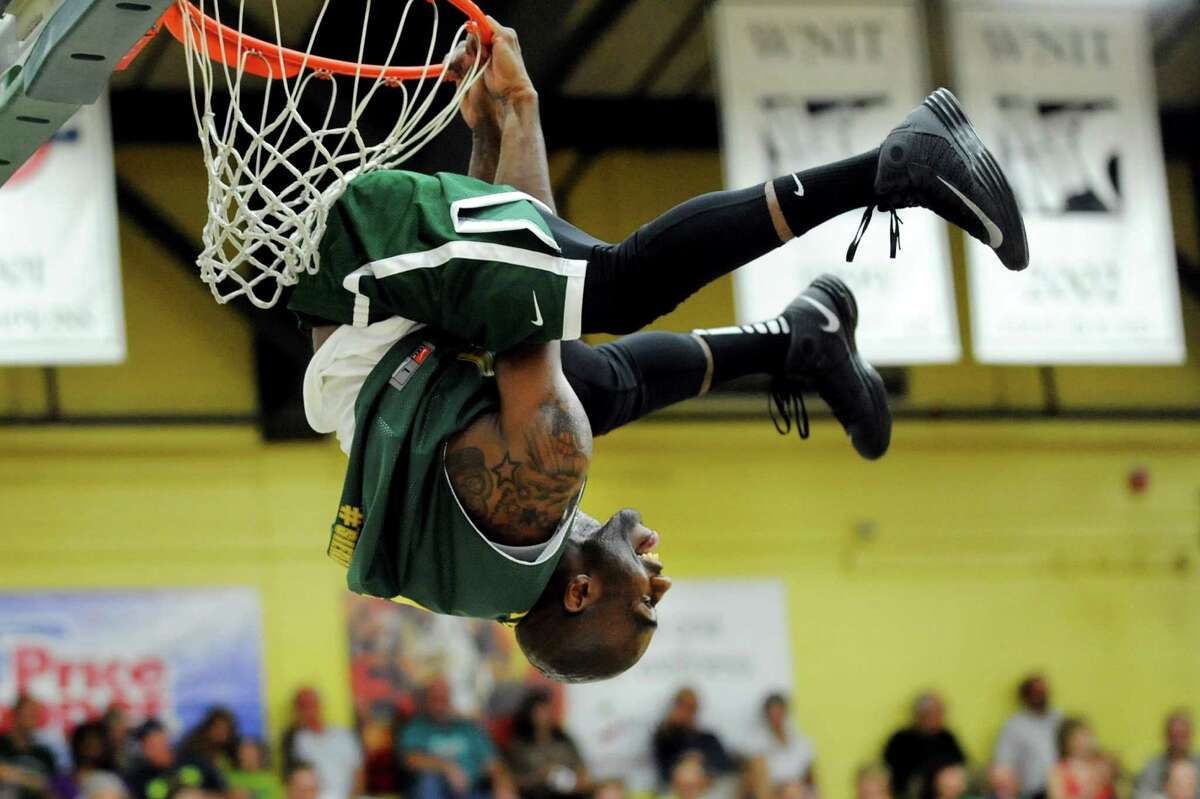 Tay Fisher, who plays for the Globe Trotters, plays to the crowd during the Siena Legends basketball game on Thursday, July 19, 2012, at Siena College in Loudenville, N.Y. (Cindy Schultz / Times Union)
