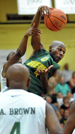 Tay Fisher fights for the rebound during the Siena Legends basketball game on Thursday, July 19, 2012, at Siena College in Loudenville, N.Y. (Cindy Schultz / Times Union) Photo: Cindy Schultz / 00018508A