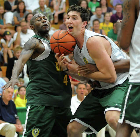 Tay Fisher, left, and Ryan Rossiter fight for a rebound during the Siena Legends basketball game on Thursday, July 19, 2012, at Siena College in Loudenville, N.Y. (Cindy Schultz / Times Union) Photo: Cindy Schultz / 00018508A