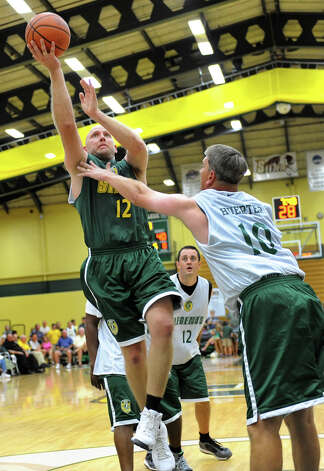 Bruce Schroeder, left, goes for the hoop as Tom Huerter, right, defends during the Siena Legends basketball game on Thursday, July 19, 2012, at Siena College in Loudenville, N.Y. (Cindy Schultz / Times Union) Photo: Cindy Schultz / 00018508A