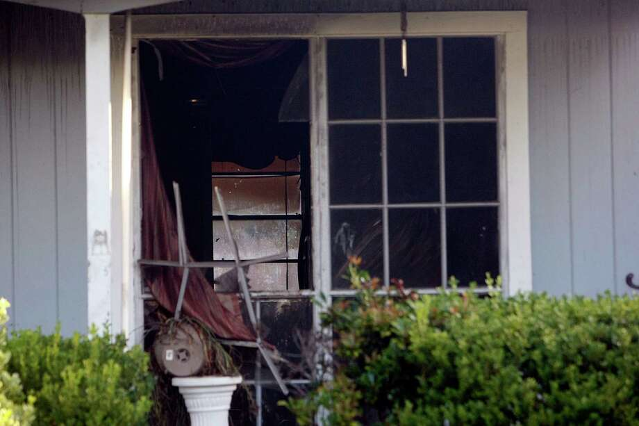 A window is broken at the burned home in the 4700 block of Cicada near Boreas in northeast Harris County late Wednesday night. Photo: Johnny Hanson / © 2012  Houston Chronicle
