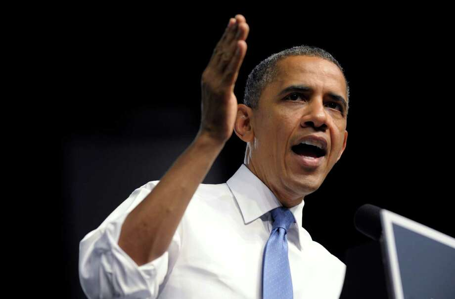 President Barack Obama speaks at a campaign event at the Prime Osborn Convention Center in Jacksonville, Fla., Thursday, July 19, 2012. Obama is spending two days in Florida campaigning. (AP Photo/Susan Walsh) Photo: Susan Walsh
