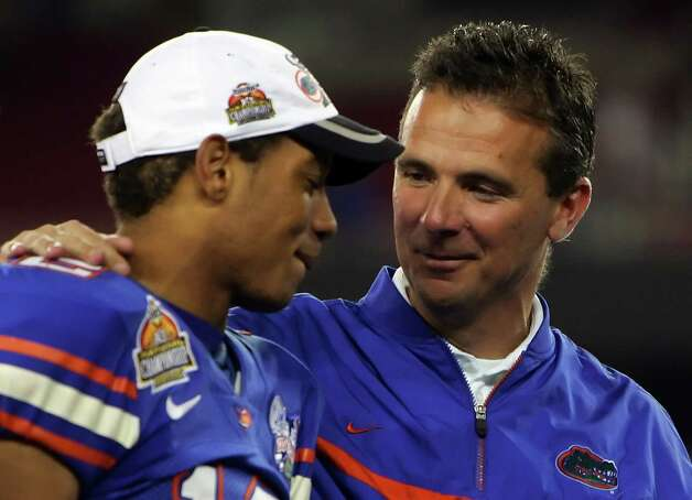 2006: Head coach Urban Meyer of the Florida Gators and quarterback Chris Leak #12 celebrate after defeating the Ohio State Buckeyes after the 2007 Tostitos BCS National Championship Game at the University of Phoenix Stadium on January 8, 2007 in Glendale, Arizona. The Gators defeated the Buckeyes 41-14. Photo: Jed Jacobsohn, Getty Images / 2007 Getty Images
