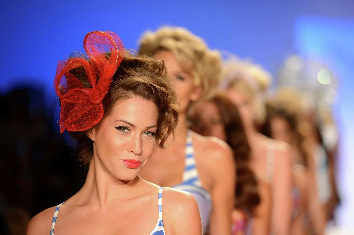 Models walk the runway at the Lisa Blue show on the opening day of Mercedes-Benz Fashion Week Swim 2013 at The Raleigh in Miami Beach, Fla. on July 19, 2013.