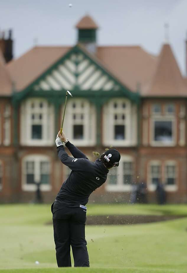 Rory McIlroy of Northern Ireland plays to the 18th green at Royal Lytham & St Annes golf club during the first round of the British Open Golf Championship, Lytham St Annes, England, Thursday, July 19, 2012. (AP Photo/Chris Carlson) Photo: Chris Carlson, Associated Press