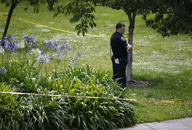 A police officer guards the scene of an officer involved shooting at Washington and Davis streets in San Francisco, Calif. on Wednesday, July 18, 2012. Officers shot and wounded a man who is suspected of stabbing a co-worker at the TCHO chocolate factory several blocks away. Photo: Paul Chinn, The Chronicle