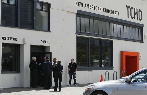 Police officers investigate a stabbing incident at the TCHO chocolate factory on Pier 17 after one employee stabbed another in an unprovoked attack in San Francisco, Calif. on Wednesday, July 18, 2012. The suspect was later shot and wounded by officers at Washington and Davis streets, several blocks away. Photo: Paul Chinn, The Chronicle