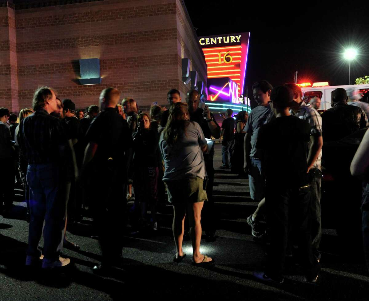 Aurora Police respond to the Century 16 movie theatre early Friday morning, July 20, 2012. Police chief Dan Oates said at least 14 dead and another 50 injured in the Colorado theater shooting.