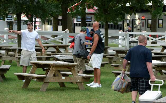The gates open and racing fans run to secure their spot in the picnic area on opening day of the 144th race meeting of Saratoga Race Course in Saratoga Springs, N.Y. July 20, 2012.   (Skip Dickstein / Times Union) Photo: SKIP DICKSTEIN