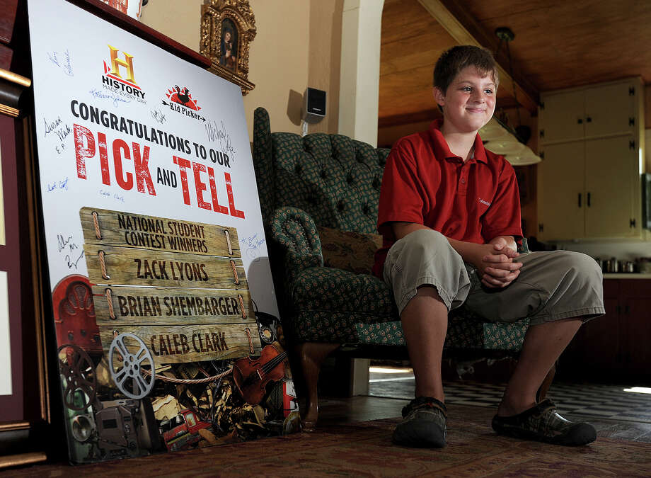 Zack Lyons talks about his experiences after winning first place in the History Channel's Kid Pickers contest. The young collector from Port Neches won a $10,000 scholarship, a trip to Washington D.C. and an ipad. Photo taken Thursday, July 19, 2012 Guiseppe Barranco/The Enterprise Photo: Guiseppe Barranco, STAFF PHOTOGRAPHER / The Beaumont Enterprise