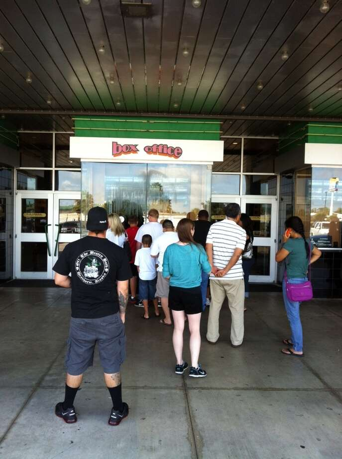 """People line up early Friday for tickets to """"The Dark Knight Rises"""" at Cinemark Tinseltown theater in Beaumont. Ioanna Makris/The Enterprise"""