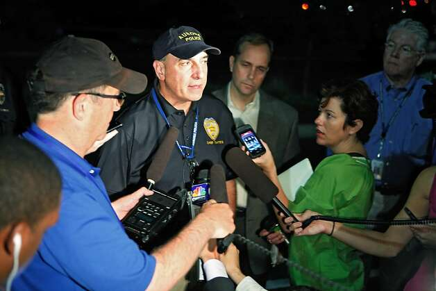 Aurora Police Chief Daniel Oates talks to media at the Aurora Mall where as many as 14 people were killed and many injured at a shooting at the Century 16 movie theatre in Aurora, Colo., Friday, July 20, 2012. (AP Photo/Ed Andrieski) Photo: Ed Andrieski, Associated Press