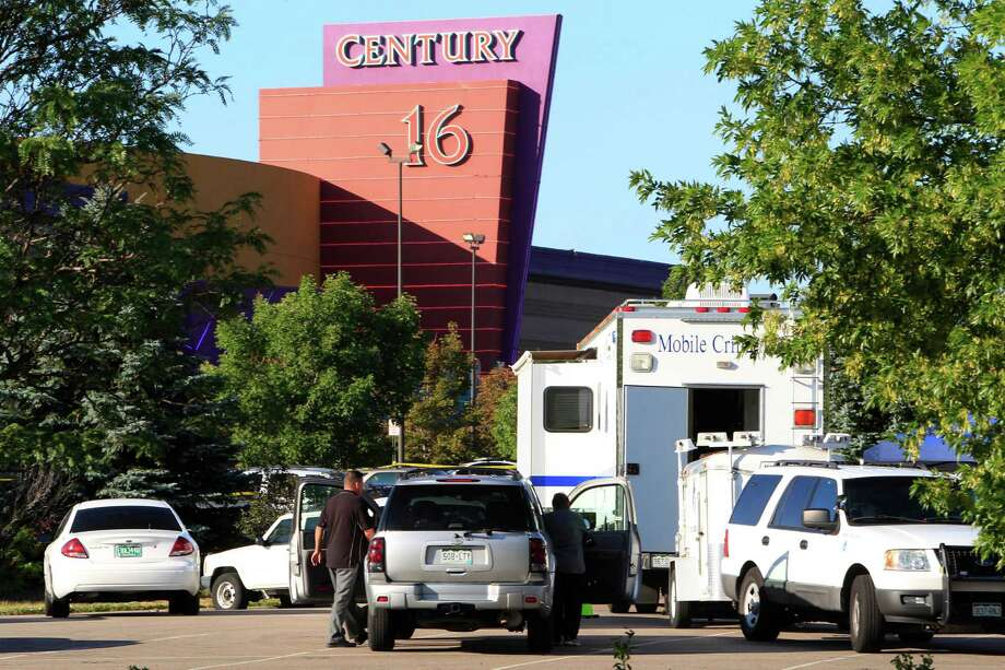 Police officers arrive at the Century 16 theatre east of the Aurora Mall in Aurora, Colo., on Friday, July 20, 2012.   A gunman wearing a gas mask set off an unknown gas and fired into the crowded movie theater killing 12 people and injuring at least 50 others, authorities said.  (AP Photo/David Zalubowski) Photo: David Zalubowski, ASSOCIATED PRESS / AP2012