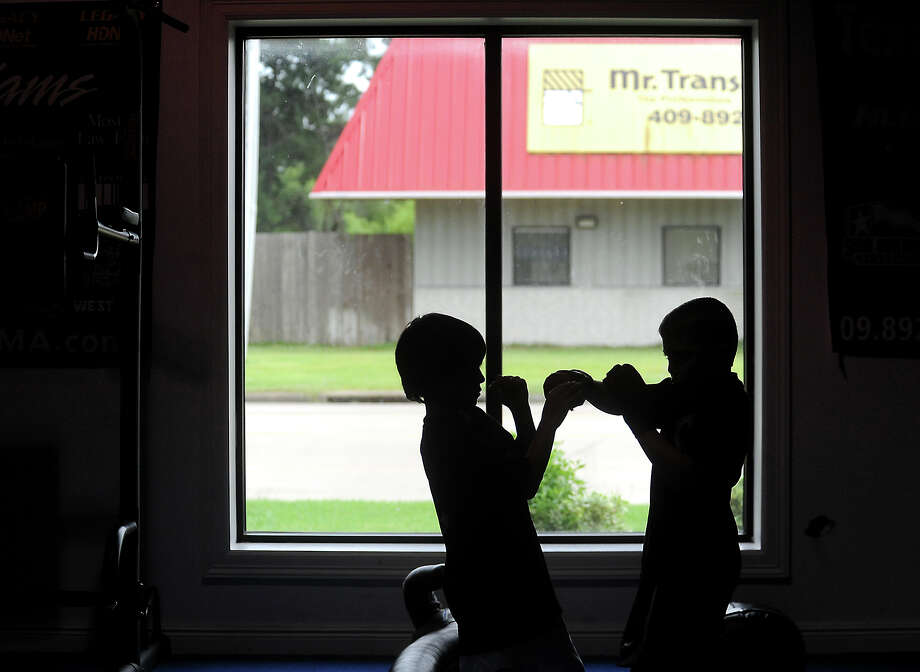 Children spar during a mixed martial arts class at the Texas Karate Academy, Wednesday, July 11, 2012. Tammy McKinley/The Enterprise Photo: TAMMY MCKINLEY