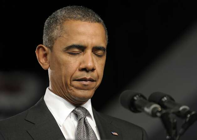President Barack Obama pauses during a moment of silence for the victims of the Aurora, Colo., shooting during an event at the Harborside Event Center in Ft. Myers, Fla., Friday, July 20, 2012. Obama said the tragic movie theater shooting in Colorado that left 12 people dead is a reminder that life is fragile. (AP Photo/Susan Walsh) Photo: Susan Walsh, Associated Press