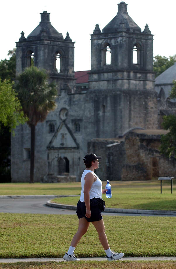 SA LIFE - Reporter Camille Flores walks the San Antonio Missions Hike and Bike Trail near Mission Concepcion on Friday, Aug. 6, 2004. (Kin Man Hui/staff) Photo: KIN MAN HUI, SAN ANTONIO EXPRESS-NEWS / SAN ANTONIO EXPRESS-NEWS