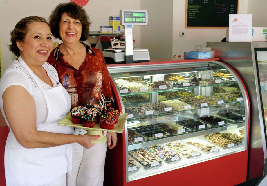 Managing Partners Diana Gould, left, and Helen Danial, right, pose for a photo at Chocolate Rain in Norwalk on Tuesday, July 17, 2012. Photo: Lindsay Niegelberg / Stamford Advocate