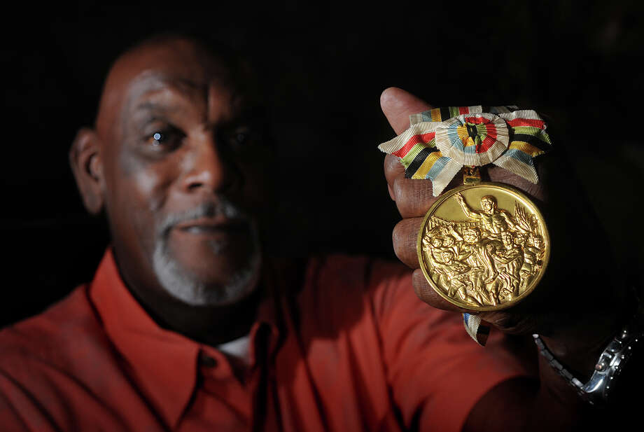 Luke Jackson of Beaumont shows the gold medal he won during the 1964 Olympics in Tokyo. Jackson played basketball for The U.S. and is now retired as the director of Parks and Recreation for the City of Beaumont.  Photo taken Tuesday, July 17, 2012 Guiseppe Barranco/The Enterprise Photo: Guiseppe Barranco, STAFF PHOTOGRAPHER / The Beaumont Enterprise