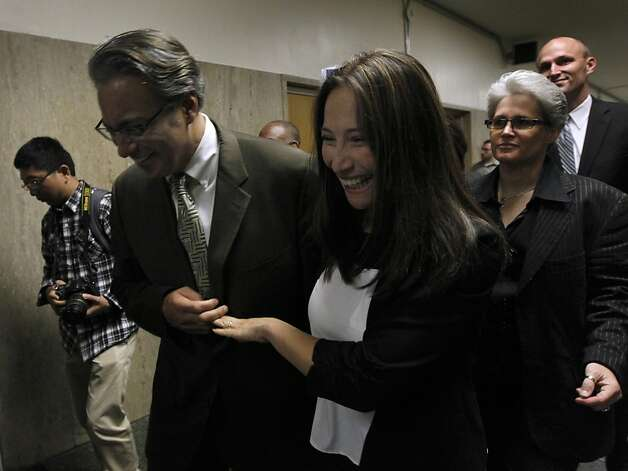 Suspended Sheriff Ross Mirkarimi and his wife Eliana Lopez leave the Hall of Justice after Judge Garrett Wong lifted the stay-away order that had prevented them from having any contact, in San Francisco, Calif. on Friday, July 20, 2012. Photo: Paul Chinn, The Chronicle